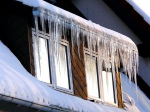 Roof of a house covered in icicles