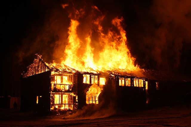 Home caught in flames at night