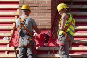 Construction workers replacing a roof