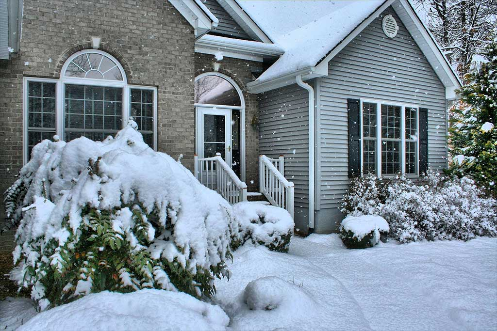 Exterior of house covered in snow