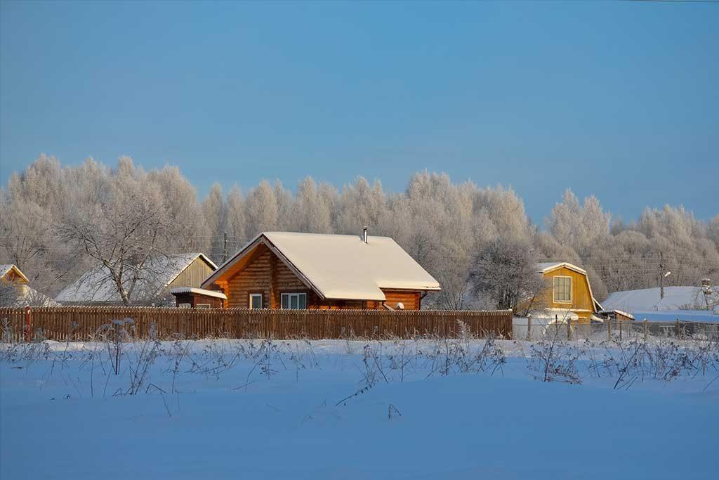 Neighborhood homes covered in snow