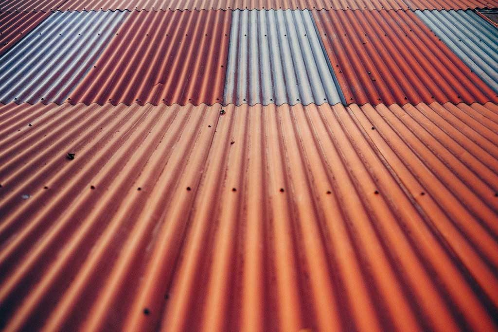 Metal roofing materials for commercial buildings