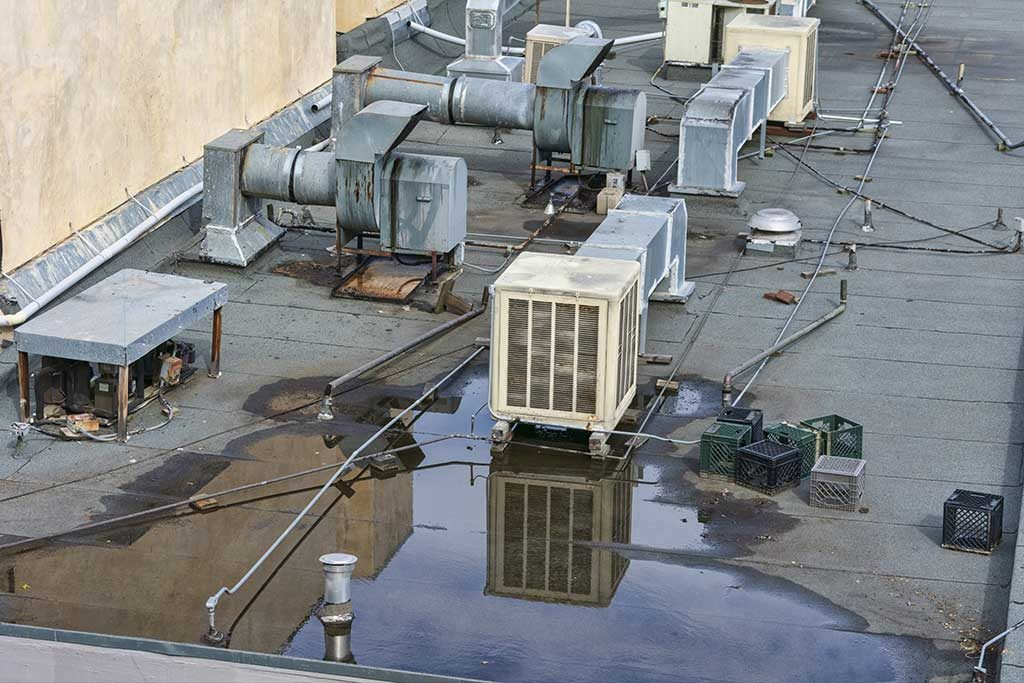 Water resting on commercial building flat roof