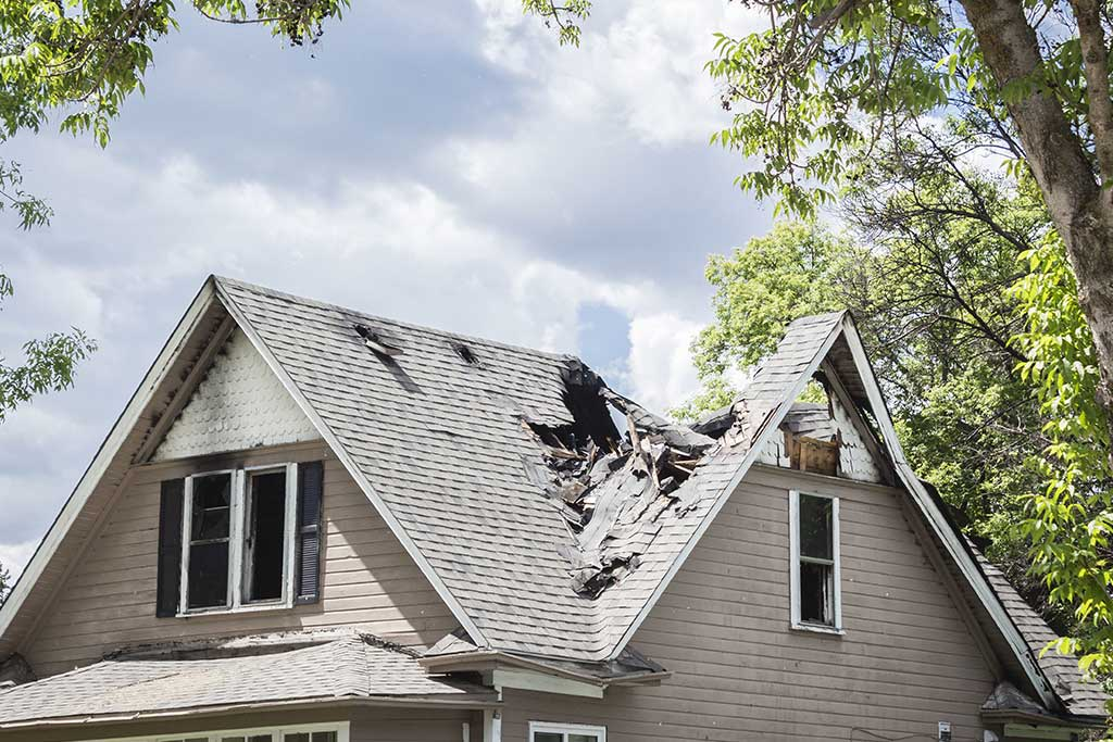 Collapsed roof needing restoration