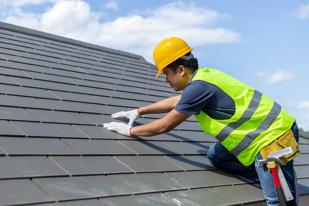 Roofing contractor inspecting roof
