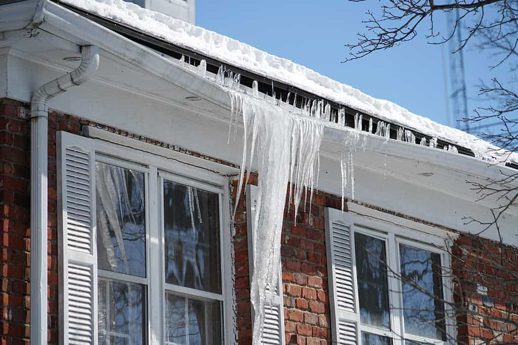 Ice dam on roof and in gutter