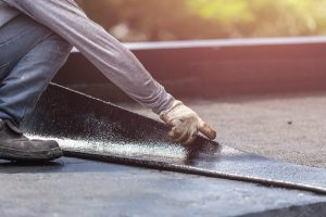 Contractor installing a flat roof