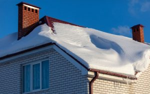 Snow on a roof in winter