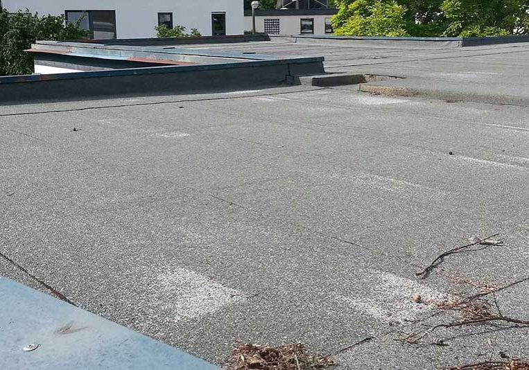 Damaged flat roof on commercial building